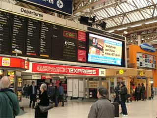Large indoor digital LED screen at the Victoria railway station in London