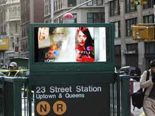 Outdoor screen at the entrance to NY metro station