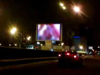 The indecent video clip on an outdoor screen in Moscow