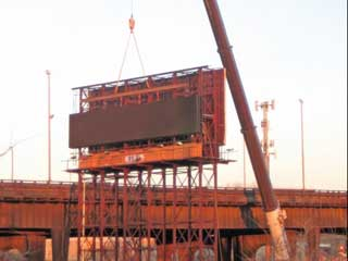 New concrete foundation support the additional weight of the LED sign cabinets