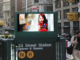 Outdoor screens near subway entrances in New York