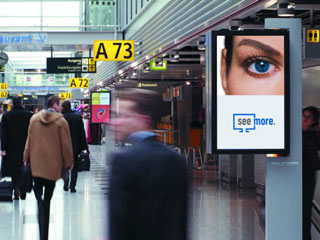 The NEC advertising LCD screens in 2-nd Terminal of the Heathrow Airport in London