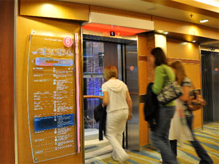 Etched glass signs by each elevator