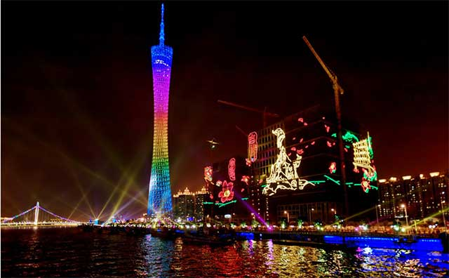 Night-time Guangzhou lit by LED screens and strips