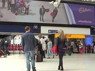 Digital interactive acquaintance at the LED screen in Waterloo Station (London, UK)